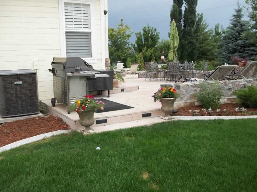 Patio landscaping with mulched planters and plants green for General garden maintenance