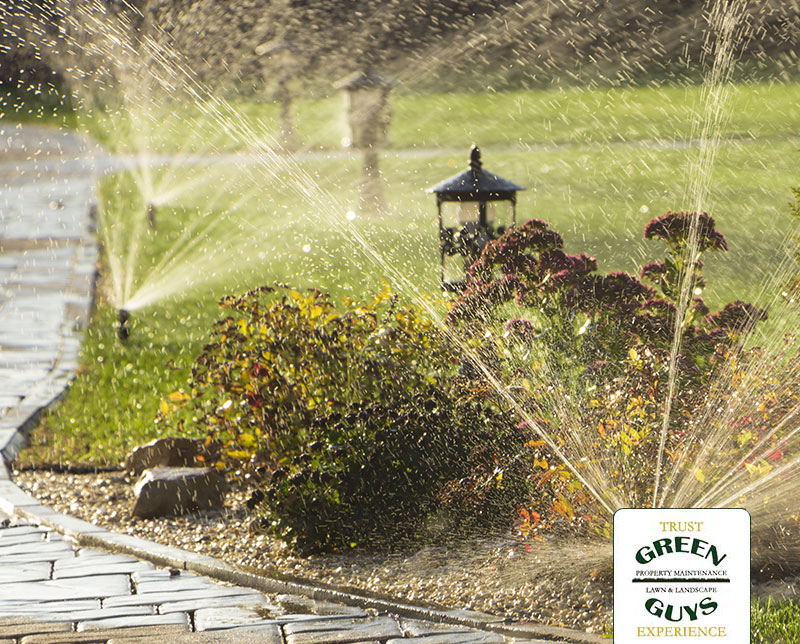 Sprinklers watering landscaping